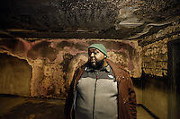 "Danny Barber, 41, stands in the burnt out lobby of the 18th floor of the ""Morrisania Air Rights"" building at 3204 Park Ave. in the Morrisania section of the Bronx on Wednesday, March 2, 2011.  In December of 2010, a mattress was left in this lobby and set on fire, causing noticeable damage.  After three months, NYCHA has yet to restore the damaged lobby.  Barber, the tenant association's president at the nearby Andrew Jackson houses, has been lending a hand to the tenants at this public housing building with getting NYCHA to fix the damages."