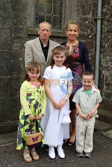 Dénagh Hughes with her family at the 2011 Donore NS First Holy Communion...(Photo credit should read Jenny Matthews www.newsfile.ie)....This Picture has been sent you under the conditions enclosed by:.Newsfile Ltd..The Studio,.Millmount Abbey,.Drogheda,.Co Meath..Ireland..Tel: +353(0)41-9871240.Fax: +353(0)41-9871260.GSM: +353(0)86-2500958.email: pictures@newsfile.ie.www.newsfile.ie.
