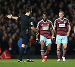 West Ham's Alex Song and Kevin Nolan argue with referee Mark Clattenburg<br /> <br /> Barclays Premier League- West Ham United vs Manchester United  - Upton Park - England - 8th February 2015 - Picture David Klein/Sportimage