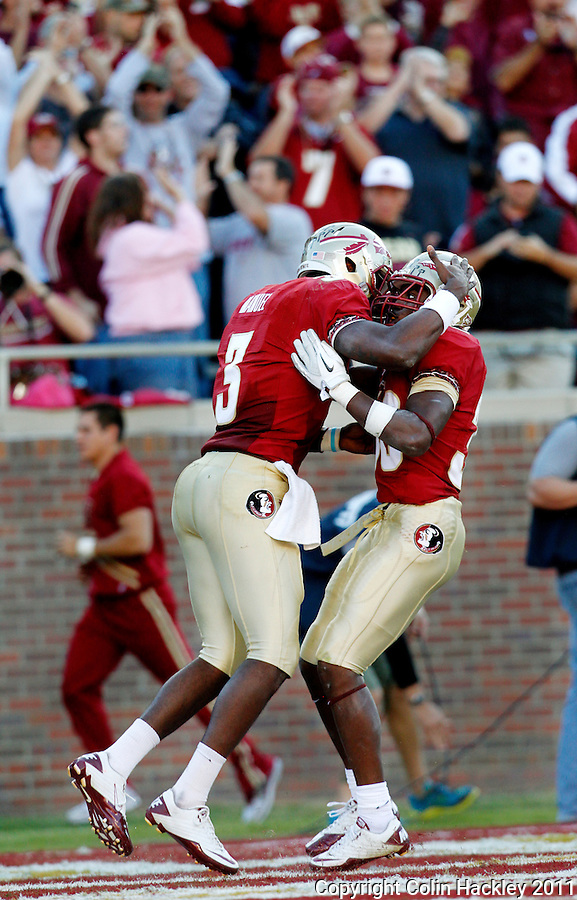 TALLAHASSEE, FL 10/22/11-FSU-MARY102211 CH-Florida State's EJ Manuel, left celebrates with Jermaine Thomas after Thomas scored a touchdown against Maryland during second half action Saturday at Doak Campbell Stadium in Tallahassee. The Seminoles beat the Terrapins 41-16..COLIN HACKLEY PHOTO