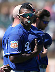 Los Angeles Dodgers&rsquo; Yasiel Puig listens to the National Anthem before a spring training game in Scottsdale, Ariz., on Friday, March 18, 2016. <br />Photo by Cathleen Allison