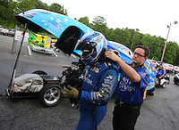 May 15, 2015; Commerce, GA, USA; A crew member helps NHRA funny car driver Tommy Johnson Jr with his safety gear during qualifying for the Southern Nationals at Atlanta Dragway. Mandatory Credit: Mark J. Rebilas-USA TODAY Sports