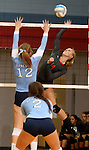 SIOUX FALLS, SD - SEPTEMBER 16: Madison Aasen #14 from Washington tries for a kill past Izzy VanVeldhuizen #12 from Lincoln in the first game of their match Tuesday night at Lincoln.  (Photo by Dave Eggen/Inertia)