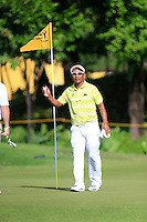Thongchai Jaidee (THA) after getting a Hole-In-One on the 11th during Round 3 of the Maybank Malaysian Open at the Kuala Lumpur Golf & Country Club on Saturday 7th February 2015.<br /> Picture:  Thos Caffrey / www.golffile.ie