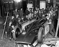 BNPS.co.uk (01202 558833)<br /> Pic: NMM/BNPS<br /> <br /> The Golden Arrow after being unpacked at Daytona in 1929 - amazingly Seagrave drove the car off the beach and back to its garage after its record run.<br /> <br /> Golden shot in the arm - Beautiful record breaker Golden Arrow is to receive new funding 90 years after smashing the Land speed record for Britain.<br /> <br /> The National Motor Museum at Beaulieu has been awarded £75,000 by Arts Council England to allow fresh research into the historic machine and the collections relating to it, as well as some conservation work on particularly fragile items.  <br /> <br /> The distinctive 1929 Golden Arrow was a wonder of its time, a harmonious blend of technology and design, produced a masterpiece of Art Deco expression which paved the way for two decades of unbroken British world record-breaking success.<br /> <br /> With Major Henry Segrave in the driving seat,  the arrow shattered its target and set a new Land Speed Record of 231.36mph at Daytona Beach in Florida in March 1929.