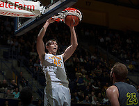 David Kravish of California dunks the ball during the game against UC Irvine at Haas Pavilion in Berkeley, California on December 2nd, 2013.  California defeated UC Irvine, 73-56.
