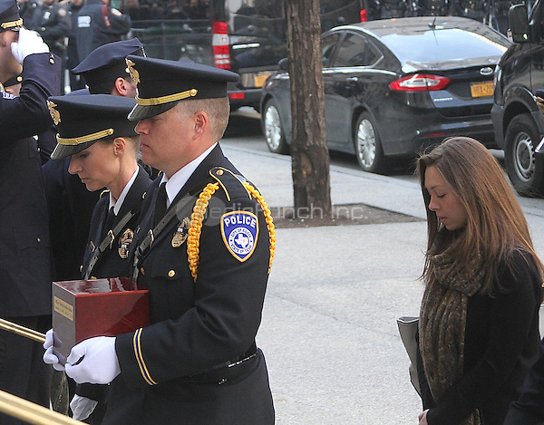NEW YORK, NY - MARCH 7:  Euless, Texas police officer carrying box containing the ashes of slain officer David Hofer accompanied by Hofer's fiance Marta Danylyk at memorial service for slain Euless, Texas police officer and ex-NYPD officer David Hofer  held at St. Patrick's Cathedral in New York, New York on March 7, 2016. Photo Credit: Rainmaker Photo/MediaPunch