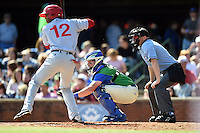 Hagerstown Suns outfielder Rafael Bautista (12), Lexington Legends catcher Chad Johnson (7) and home plate umpire Cody Waterhouse during a game against the Hagerstown Suns on May 19, 2014 at Whitaker Bank Ballpark in Lexington, Kentucky.  Lexington defeated Hagerstown 10-8.  (Mike Janes/Four Seam Images)