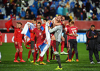 Serbia players celebrate winning the FIFA Under-20 Football World Cup Final between Brazil (gold) and Serbia at North Harbour Stadium, Albany, New Zealand on Saturday, 20 June 2015. Photo: Dave Lintott / lintottphoto.co.nz