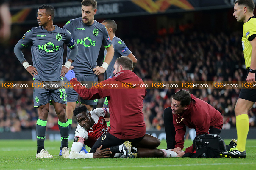 Arsenal's Danny Welbeck looks in agony as he lies injured awaiting the stretcher during Arsenal vs Sporting Lisbon, UEFA Europa League Football at the Emirates Stadium on 8th November 2018