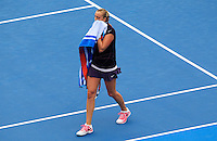 Petra Kvitova of Czech Republic wipes her face after losing a point against Tsvetana Pironkova of Bulgaria during their semi-final match at the Sydney International tennis tournament, Jan. 9, 2014.  Daniel Munoz/Viewpress IMAGE RESTRICTED TO EDITORIAL USE ONLY