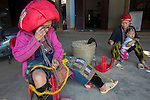 Ethnic Red Dzao tribe woman embroidering traditional clothing, Vietnam