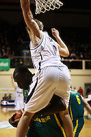 Tall Blacks forward Tom Abercrombie lands on Nathan Jawai after scoring during the International basketball match between the NZ Tall Blacks and Australian Boomers at TSB Bank Arena, Wellington, New Zealand on 25 August 2009. Photo: Dave Lintott / lintottphoto.co.nz