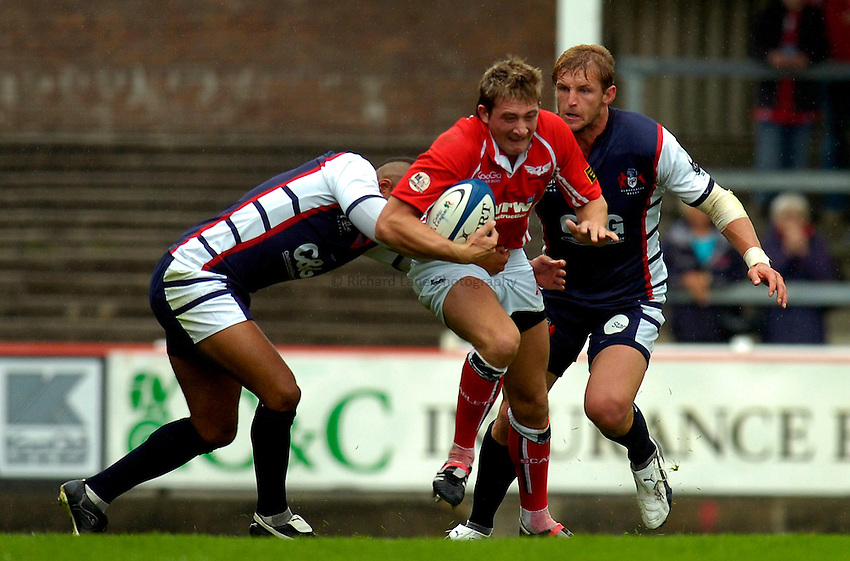 Photo: Alan Crowhurst..Llanelli Scarlets v Gloucester Rugby. Pre Season Friendly. 19/08/2006. Darren Daniel (C) of Llanelli.