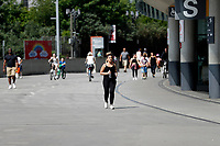 9th May 2020, Emirates  Stadium, London, England; Female runner exercising outside the Emirates Stadium  during the Covid-19 lockdown