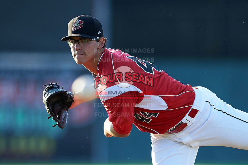 Batavia Muckdogs pitcher Justin Jacome (44) follows through on a warmup pitch during a game against the Williamsport Crosscutters on July 15, 2015 at Dwyer Stadium in Batavia, New York.  Williamsport defeated Batavia 6-5.  (Mike Janes/Four Seam Images)
