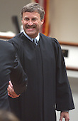 Prince William County (Virginia) Circuit Court Judge LeRoy Millette Jr., shakes the hand of prosecutors after giving final instructions to the jury in the case of sniper John Allen Muhammad in courtroom 10 at the Virginia Beach Circuit Court, Virginia Beach, Virginia on November 21, 2003.  The jury will decide whether Muhammad will be sentenced to life in prison or death. <br /> Credit: Martin Smith-Rodden - Pool via CNP