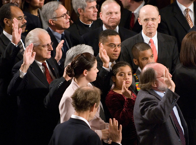 Rep. Keith Ellison, D-Minn., raises his right hand to take the oath of office as the 110th Congress in sworn in en masse on the House Floor on Thursday, Jan. 4, 2007. Ellison is the first muslim elected to Congress