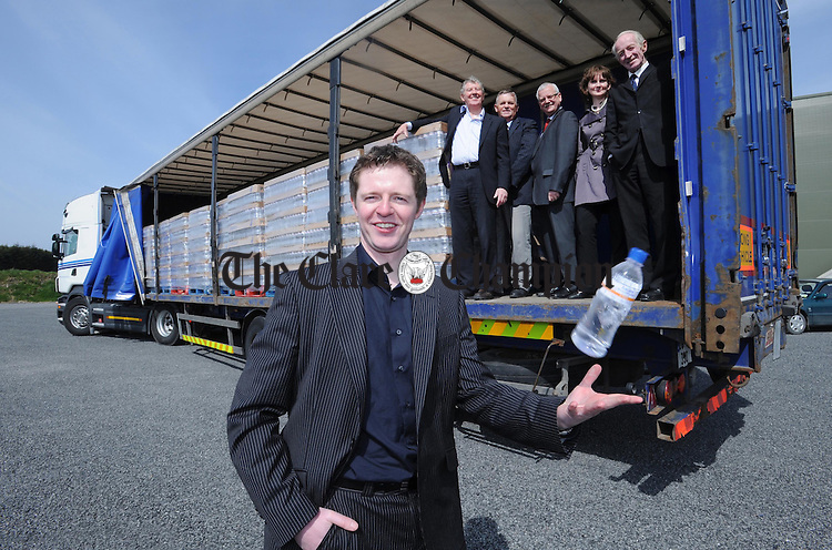 Paul Connellan, managing director of Clare Spring in Lissycasey sees off the plant's first export to the Netherlands with his father Tom; director, Ger Kennedy; Clare Local Development Company, Tom Coughlan; town manager, Doirin Graham, Clare Local Development Company and councillor P.J Kelly. Photograph by Declan Monaghan