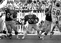 Oakland Raiders Clarence Davis with blocking from #64 George Buehler and Marv Hubbard #44 running against the Los Angles Rams.(1972 photo/Ron Riesterer)