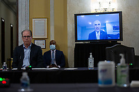 United States Senator Bob Casey, Jr. (Democrat of Pennsylvania), right, speaks via video call during a United States Senate Aging Committee hearing at the United States Capitol in Washington D.C., U.S. on Thursday, May 21, 2020.  Credit: Stefani Reynolds / CNP /MediaPunch