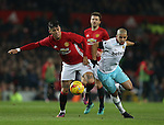 Marcos Rojo of Manchester United tussles with Sofiane Feghouli of West Ham United during the English League Cup Quarter Final match at Old Trafford  Stadium, Manchester. Picture date: November 30th, 2016. Pic Simon Bellis/Sportimage