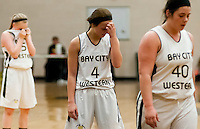 Bay City Western's Meredith Rousse, center, holds her head before a free throw Tuesday, Jan. 21 at Bay City Western in Auburn. (Yfat Yossifor | The Bay City Times)