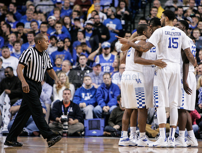 Kentucky's men's basketball team huddles during the second half of the UK vs. UT-Arlington game at Rupp Arena on Tuesday, November 25, 2014 in Lexington, Ky. UK defeated UT-Arlington 92-44. Photo by Adam Pennavaria | Staff