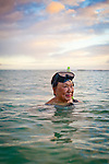 Linda Yuen, world traveler, even at the age of 84, based in Honolulu, is active and an avid snorkeler.  Photographed at local Sans Souci Beach near Waikiki, Honolulu, Hawaii