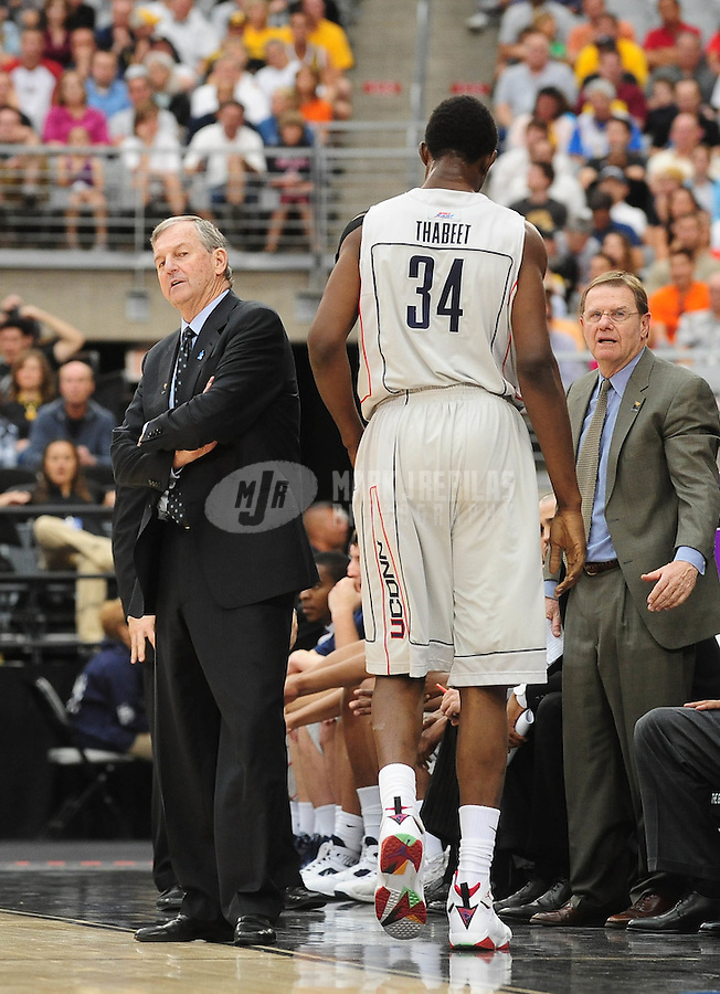 Mar 28, 2009; Glendale, AZ, USA; Connecticut Huskies center Hasheem Thabeet walks past head coach Jim Calhoun against the Missouri Tigers during the finals of the west regional in the 2009 NCAA mens basketball tournament at the University of Phoenix Stadium. The Huskies defeated the Tigers 82-75 to advance to the final four. Mandatory Credit: Mark J. Rebilas-