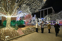 NWA Democrat-Gazette/J.T. WAMPLER Visitors to the Fayetteville square walk among the Lights of the Ozarks display Sunday Dec. 31, 2017 before Last Night Fayetteville. Last Night is a performing arts festival featuring more than 100 local artists on 11 stages.