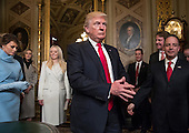 United States President Donald Trump leaves the President's Room of the Senate at the Capitol after he formally signed his cabinet nominations into law, in Washington, Friday, Jan. 20, 2017. He is joined by his wife Melania Trump and and daughter Tiffany Trump. At far right is Chief of Staff Reince Priebus, with White House counsel Donald McGahn, second from right. <br /> Credit: J. Scott Applewhite / Pool via CNP