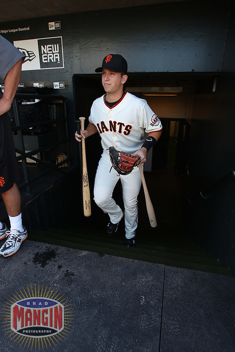 SAN FRANCISCO - JUNE 26:  Buster Posey of the San Francisco Giants enters the dugout before the game against the Boston Red Sox on June 26, 2010 in San Francisco, California. Photo by Brad Mangin