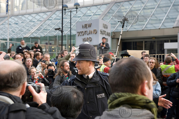 Photographers protesting outside New Scotland Yard in Westminster, London, on 16 February 2009, the day a new law was introduced that allows for the arrest and imprisonment of anyone who takes pictures of police officers 'likely to be useful to a person committing or preparing an act of terrorism'. The new set of rules, under section 76 of the 2008 Act and section 58A of the 2000 Act, will target anyone who 'elicits or attempts to elicit information about (members of armed forces) ... which is of a kind likely to be useful to a person committing or preparing an act of terrorism'. A person found guilty of this offence could be liable to imprisonment for up to 10 years, and to a fine. The law is expected to increase the anti-terrorism powers used today by police officers to stop photographers, including press photographers, from taking pictures in public places..