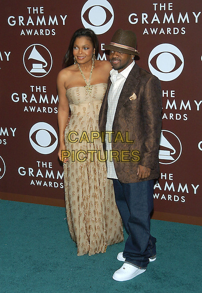 JANET JACKSON & JERMAINE DUPRI.47th Annual Grammy Awards - Arrivals. Los Angeles, California .February 13th, 2005.Photo Credit: Jacqui Wong/AdMedia.full length strapless beige brown gold dress brown suit jacket hat jeans denim.www.capitalpictures.com.sales@capitalpictures.com.© Capital Pictures.