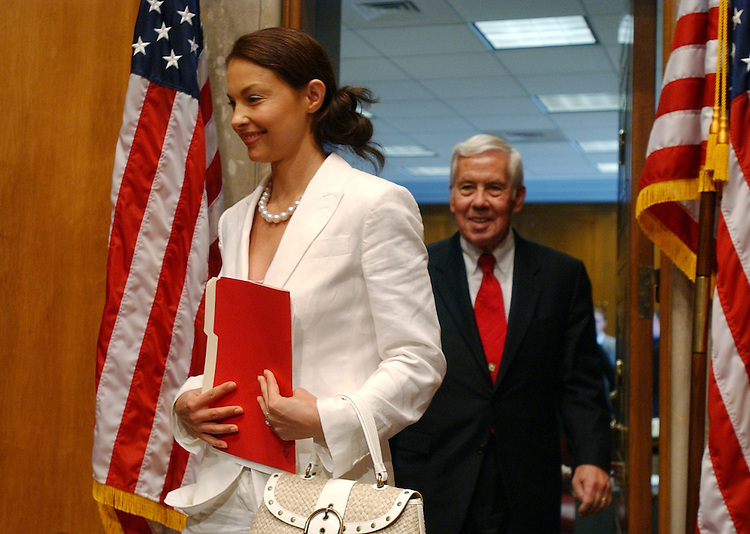 Actress Ashley Judd arrives with Sen. Dick Lugar, R-Ind., to a Senate Foreign Relations Committee hearing which looked at the future of HIV/AIDS and an the initiative to develop an AIDS vaccine.  Judd is the global ambassador for Youth AIDS.