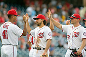 Washington Nationals starting pitcher Joe Ross (41), third baseman Anthony Rendon (6), and first baseman Clint Robinson (25) celebrate their team's 9 - 1 victory over the Atlanta Braves at Nationals Park in Washington, D.C. on Sunday, August 14, 2016.  The Nationals won the game 9 - 1.<br /> Credit: Ron Sachs / CNP