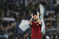 Calcio, Serie A: S.S. Lazio - A.S. Roma, stadio Olimpico, Roma, 15 aprile 2018. <br /> Roma's captain Daniele De Rossi greets supporters at the end of the Italian Serie A football match between S.S. Lazio and A.S. Roma at Rome's Olympic stadium, Rome on April 15, 2018. <br /> S.S. Lazio and A.S. Roma drawn 0-0.<br /> UPDATE IMAGES PRESS/Isabella Bonotto