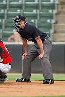 Umpire Derek Mollica calls the balls and strikes during the South Atlantic League game between the Hickory Crawdads and the Kannapolis Intimidators at Fieldcrest Cannon Stadium August 18, 2010, in Kannapolis, North Carolina.  Photo by Brian Westerholt / Four Seam Images