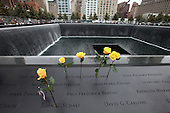 On the 10th anniversary of the September 11th attacks, flowers were left at the North Memorial Pool at opening day of the September 11th Memorial at the World Trade Center site in New York, New York on Sunday, September 11, 2011..Credit: Jefferson Siegel / Pool via CNP