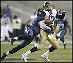 St. Louis Rams quarterback Jamie Martin looses ball as he gets hits by Seattle Seahawks linebacker Tim Terry on Sunday, Dec. 22, 2002 at Seahawks Stadium. Seahawks Chad Eaton recovered the ball to stop the drive as Seattle beat St. Louis 30-10. (Jim Bryant/AP Photo)