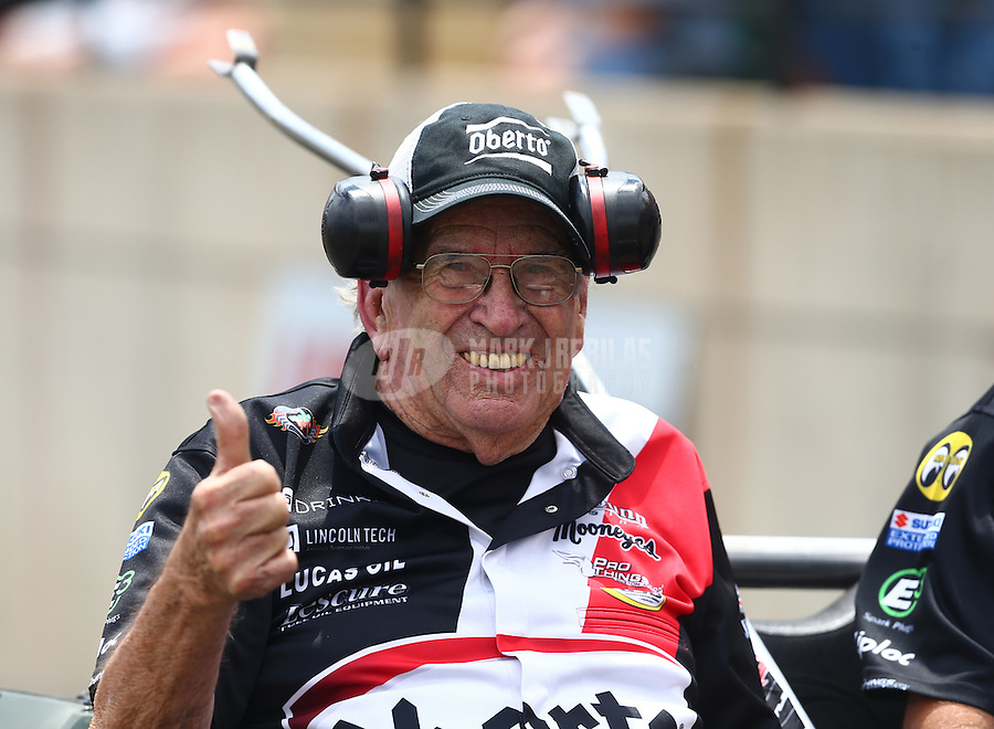 Jul 24, 2016; Morrison, CO, USA; NHRA funny car team owner Jim Dunn smiles as he reacts during the Mile High Nationals at Bandimere Speedway. Mandatory Credit: Mark J. Rebilas-USA TODAY Sports