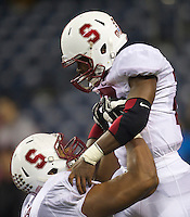 SEATTLE, WA - September 28, 2013: Stanford running back Barry Sanders, right, celebrates a touchdowns with offensive lineman Joshua Garnett during play against Washington State at CenturyLink Field. Stanford won 55-17