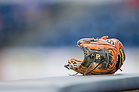 A baseball glove sits on top of the railing in the home dugout during the Atlantic Coast Conference game between the Virginia Cavaliers and the Duke Blue Devils at Durham Bulls Athletic Park on April 20, 2012 in Durham, North Carolina.  The Blue Devils defeated the Cavaliers 6-3.  (Brian Westerholt/Four Seam Images)