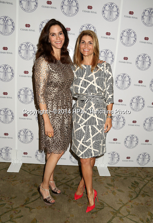 LOS ANGELES - APR 22:  Jami Gertz, Lori Loughlin at the Women's Guild Cedars-Sinai Luncheon at Beverly Hills Hotel on April 22, 2014 in Beverly Hills, CA
