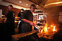 """Dudley Battie chargrills oysters at Drago's Seafood Restaurant and Oyster Bar in """"Fat City'' at one of the restaurant's five natural gas chargrills, in Metairie, Louisiana, May 23, 2003. The restaurant serves about 600 dozen chargrilled oysters on a busy day.<br /> (AP PHOTO/CHERYL GERBER)"""