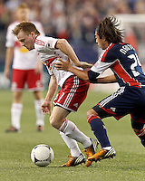 New York Red Bulls midfielder Dax McCarty (11) dribbles as New England Revolution midfielder Lee Nguyen (24) defends. Despite a red-card man advantage, in a Major League Soccer (MLS) match, the New England Revolution tied New York Red Bulls, 1-1, at Gillette Stadium on September 22, 2012.