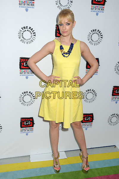 "Beth Behrs.""Television: Out Of The Box"" Museum Exhibit created by Warner Bros. Television Group held at The Paley Center, Beverly Hills, California, USA..April 12th, 2012.full length yellow dress hands on hips necklace .CAP/ADM/BP.©Byron Purvis/AdMedia/Capital Pictures."