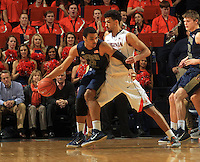 Virginia forward Anthony Gill (13) defends Georgia Tech forward Robert Sampson (13) during the game Jan. 22, 2015, in Charlottesville, Va. Virginia defeated Georgia Tech 57-28.