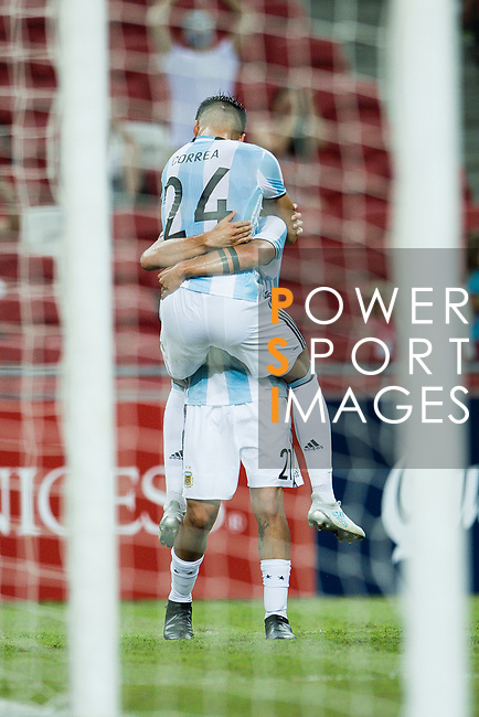 Carlos Correa of Argentina (R) celebrates after scoring his goal during the International Test match between Argentina and Singapore at National Stadium on June 13, 2017 in Singapore. Photo by Marcio Rodrigo Machado / Power Sport Images